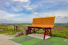 One of the colorful Giant Benches of the Langhe. One of the colorful Giant Benches, placed between the vineyards and the countryside of the Langhe royalty free stock photography