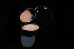 One Compact Pressed Powder onBlack Background Stock Photo