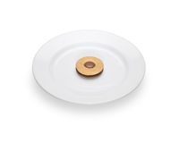 One cookie with chocolate filling lying on a white plate. Stock Photos