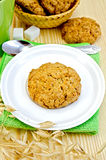 Biscuits with stalks of oats on a wooden board Stock Photo