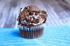 One cookies and cream cupcake on a blue stand wooden background Royalty Free Stock Images