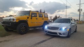 af9174abef3e4 One cool dude. Decked out Hummer H2 and 2008 Mercedes C63 AMG belong to one