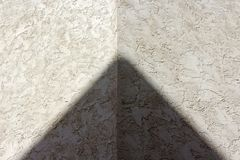 Symmetric triangle sunlight shadow. One corner of building forms a triangle under sunlight at UCSD, San Diego, California Royalty Free Stock Photo