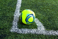 One corner of the football. A ball on the green glass at the corner point Stock Photos