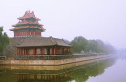 One Corner of Forbidden City in fog Stock Photo