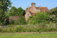 One of the cottages at Sissinghurst Castle in Kent in England in the summer. Cottage and barn in one of the gardens at Sissinghurst Castle Tower in Kent in Stock Image