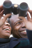 One couple looking through binoculars stock image