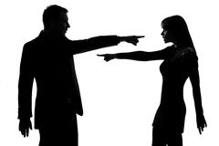 One couple man and woman Criticism concept. One caucasian couple men and women pointing at each other expressing accusation in studio silhouette isolated on Stock Images