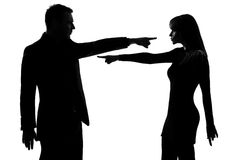 One couple man and woman Criticism concept. One caucasian couple men and women pointing at each other expressing accusation in studio silhouette isolated on Royalty Free Stock Photography