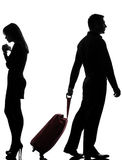 One couple man and woman dispute separation. One caucasian couple men and women dispute separation in studio silhouette isolated on white background Stock Photography
