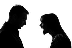 One couple man and woman screaming shouting dipute. One caucasian couple men and women face to face screaming shouting dipute in studio silhouette isolated on Stock Photo