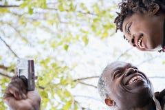 One couple using a camera stock photo