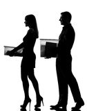 One couple walking carrying boxes Stock Photo
