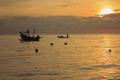 One couple will sail for fishing at dawn Stock Photo