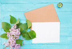 Free One Craft Envelop, White Paper, Brunch Of Lilac, Green Candle On Vintage Turquoise Wooden Background Royalty Free Stock Image - 181825146
