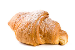 One croissant sprinkled with powdered sugar isolated on a white background closeup Royalty Free Stock Image