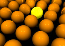 One In A Crowd. One individual standing out in a crowd. One bright yellow ball standing out amungst the rest Stock Photography