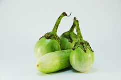 One cucumber and three eggplant Royalty Free Stock Image