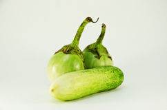 One cucumber and two eggplant Stock Photography