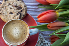 One cup of coffee with biscuit and tulips Royalty Free Stock Photo
