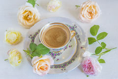 One cup of coffee and several pink roses Royalty Free Stock Photo