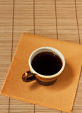 One cup of coffee on a yellow napkin Stock Photo