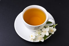 One cup of jasmine tea. On a black background Stock Photography