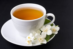 One cup of jasmine tea. On a black background Royalty Free Stock Photo