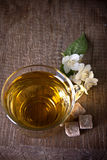 One cup of jasmine tea. On a wooden board Royalty Free Stock Photography