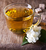 One cup of jasmine tea. On a wooden board Stock Photo