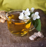 One cup of jasmine tea. On a wooden board Stock Images