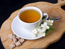 One cup of jasmine tea. On a wooden board Royalty Free Stock Images