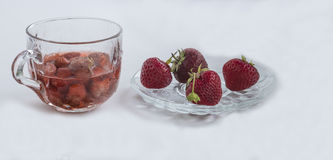 One cup of strawberries jus, four strawberries Royalty Free Stock Image