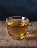 One cup of tea. On a wooden board Stock Images