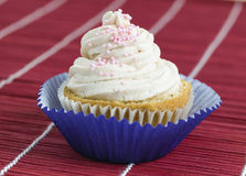 One cupcake with pink balls Stock Photo