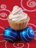 One cupcake and two christmas balls 3 Stock Photos