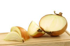 One cut fresh onion on a cutting board Stock Images