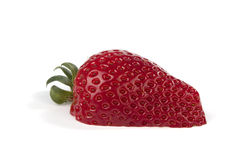 One cut in halfs strawberry on white Stock Images