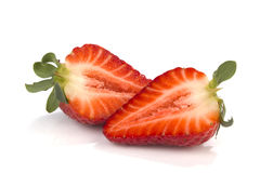One cut in halfs strawberry on white Royalty Free Stock Photos