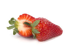 One cut in halfs strawberry on white Royalty Free Stock Image