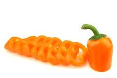 One cut orange pepper(capsicum) Stock Photos