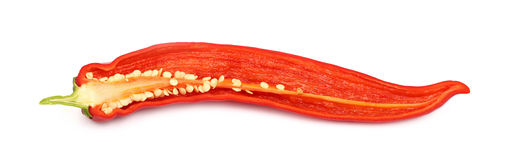 One cut red hot chili pepper close up on white Royalty Free Stock Images