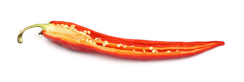 One cut red hot chili pepper close up on white Stock Images