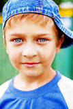 One cute kid with beautiful blue eyes Royalty Free Stock Images