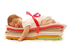 One cute little newborn baby lying on towels Royalty Free Stock Photography
