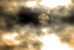 One Dark Coudy Scary Night. Sun cutting through the clouds Stock Image