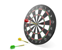 One dart hit the center of board and two missed Stock Images