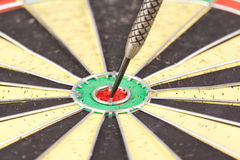 One dart in midle of the board Royalty Free Stock Images