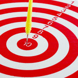 One darts in center of target isolated Stock Photos