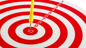 One darts in center of target isolated Royalty Free Stock Photos